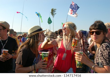 GLASTONBURY,UK - JUNE, 26: A group of festival goers enjoy a cold drink amongst a crowd at Glastonbury Festival on June 26th, 2010 at Pilton Farm in Somerset.
