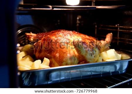 glazed chicken baking in the oven