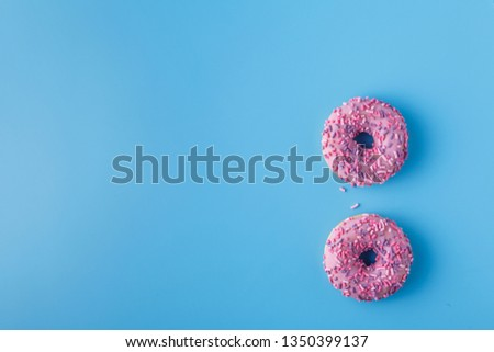 glazed donut on a monochromatic blue background #1350399137