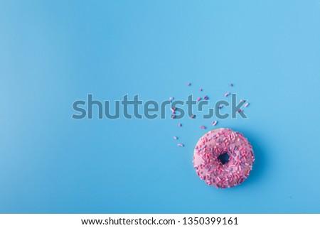 glazed donut on a monochromatic blue background #1350399161