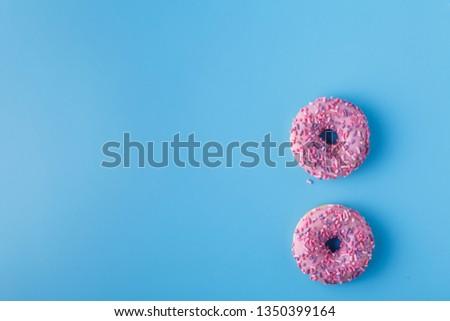 glazed donut on a monochromatic blue background #1350399164