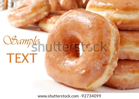 Glazed donuts on white background with copy space.  Macro with shallow dof.