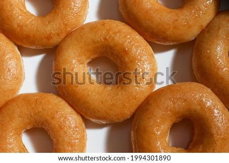 Glazed donuts original Delicious sugar pattern in box white, Selective focus Stock fotó ©