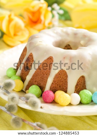 Glazed easter cake with flower and candy, selective focus