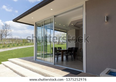 glazed terrace in the countryside with sliding glass Stockfoto ©