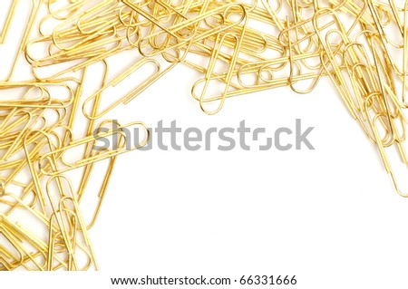 Gleaming golden paperclip isolated on white background