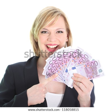 Gleeful young woman pointing to a fistful of 500 euro notes which she is holding fanned in her hand isolated on white