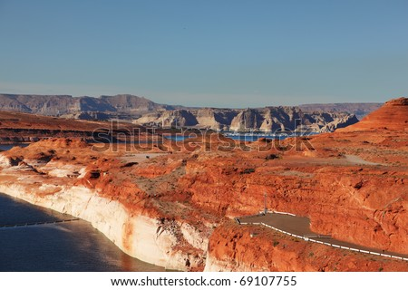 Glen Canyon Dam - the dam on the Colorado River in California. Away - blue water of Lake Powell