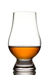 Glencairn glass with singe malt whisky in back lit