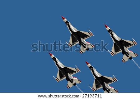 """GLENDALE, AZ - MARCH 21: The Air Force Thunderbirds perform at the biennial air show and open house (""""Thunder in the Desert"""") at Luke Air Force Base on March 21, 2009 in Glendale, AZ."""