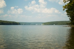 Glendale lake is graced by sailboats and a blue sky