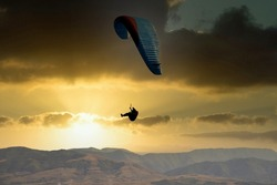 glider paragliding at sunset flying  adrenaline and freedom concept