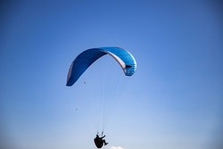 glider paragliding g against blue sky flying  adrenaline and freedom concept