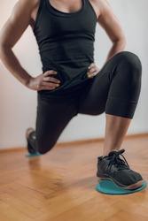 Gliding Disc Exercise. Woman Athlete