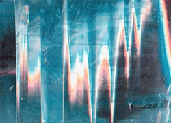 Glitch abstract background. Digital distortion. Blue white orange noise on scratched wet screen.