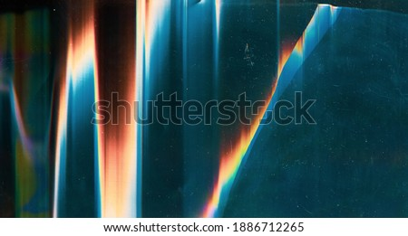 Glitch overlay. Damaged screen. Dust scratches texture. Colorful digital noise design on blue glass shattered display surface with rainbow orange red artifacts stains. Stockfoto ©