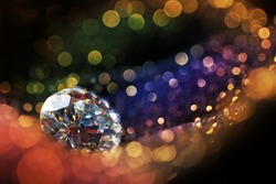 Glitter and glow soft multi colored  bokeh shining with big natural jewelry precious stone. Dark abstract dreamy wunderful sparkle background