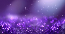 Glitter background dark purple saturated color ,de-focused, macro. Sequins fall and sparkle, free space