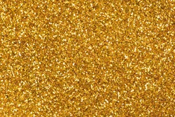 Glitter background in new stylish tone, your texture in gold tone as part of your holiday desktop. High resolution photo.