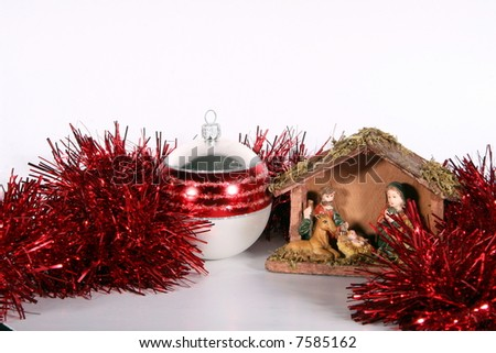 Glitter Ball And Stable A red glitter ball with a crib symbolizing Christmas. Isolated over white space (for text).