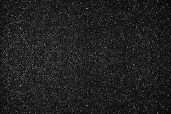 Glitter black background. Photo of monotone shiny background.