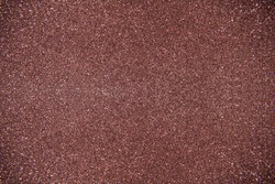 Glitter brown background. Photo of monotone shiny background.