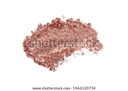Glitter eye shadow or body smear isolated on white. Beauty, fashion, festive and make up concept.