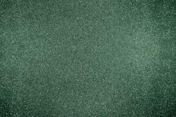 Glitter green background. Photo of monotone shiny background.