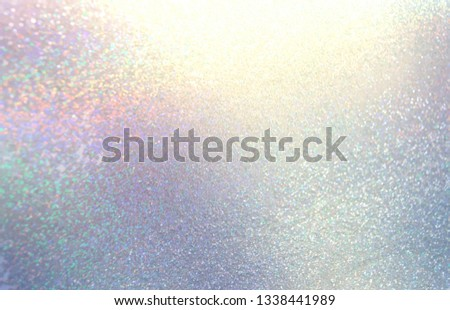 Glitter holiday abstract texture. Iridescent blue yellow lilac gradient pattern. Sparkles blurred background. Brilliance illustration.