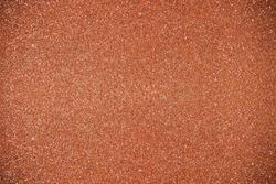 Glitter orange background. Photo of monotone shiny background.