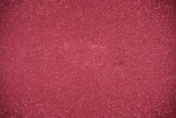 Glitter red background. Photo of monotone shiny background.