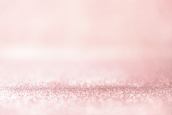 Glitter rose gold lights background. silver and pink. defocused, pastel style.