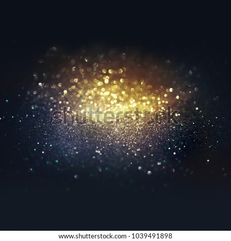 Glitter spectacular colorful dark background black and golg color , de-focused, macro. Sparks sparkle in ray of light, free space. Сток-фото ©