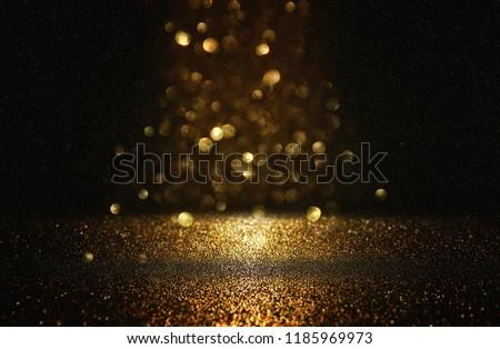 glitter vintage lights background. black and gold. de-focused #1185969973