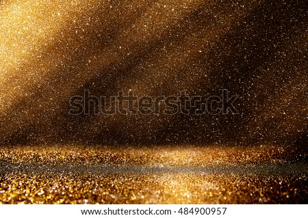 glitter vintage lights background. dark gold and black. de focused