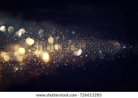 glitter vintage lights background. gold and black. defocused. #726613285