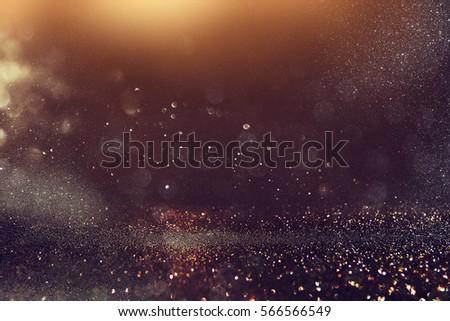 glitter vintage lights background. gold, blue and black. de-focused - Shutterstock ID 566566549