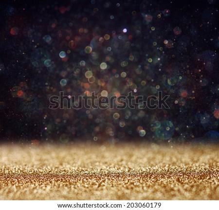 glitter vintage lights background. light gold and black. defocused