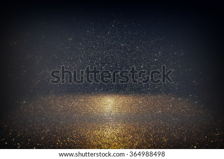 glitter vintage lights background. light silver, gold, black. defocused.
