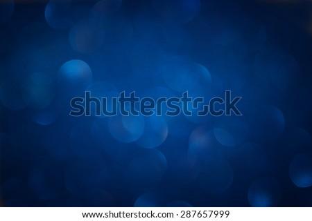 glitter vintage lights background. light silver, purple, blue, gold and black. defocused.