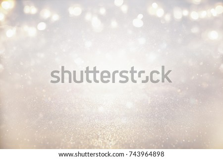 glitter vintage lights background. silver and light gold. de-focused. #743964898