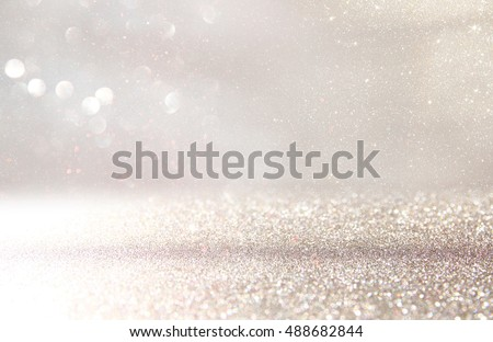 Photo of  glitter vintage lights background. silver and white. de-focused