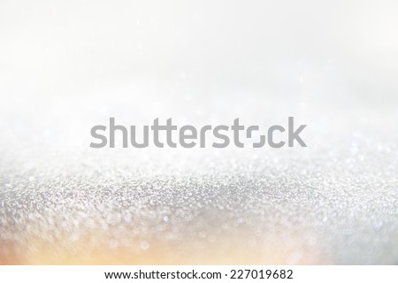 Glitter vintage lights background, the silver and blue. Image defocused. - Shutterstock ID 227019682
