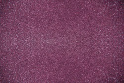 Glitter violet background. Photo of monotone shiny background.