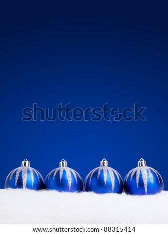 Glittering blue Christmas balls on dark  background. Copy space for your text.