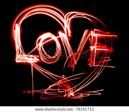 Glittering, glossy, heart, painted light, on a black background.