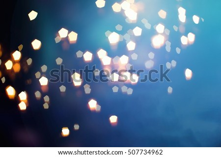 glittering shine bulbs lights background:blur of Christmas wallpaper decorations concept.holiday festival backdrop:sparkle circle lit celebrations display. #507734962