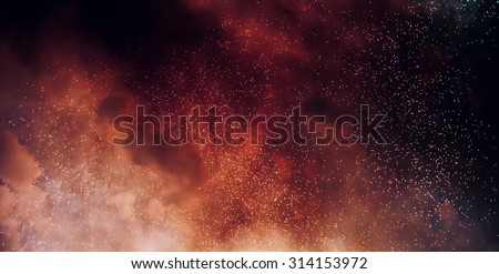 glittering stars on bokeh background sparks of bonfire night