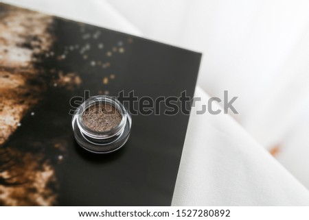 Glittery eye shadow in form of gel in glass jar. Taupe shade full of sparkles. Make up artist must have. Smokey eye product.  #1527280892