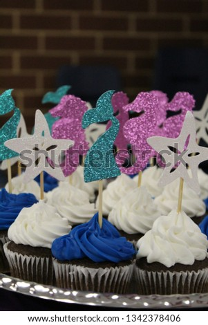 Glittery sea life chocolate cupcake toppers in blue, white, and pink